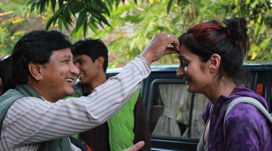Projects Abroad volunteer gets welcomed by her host family in Nepal.